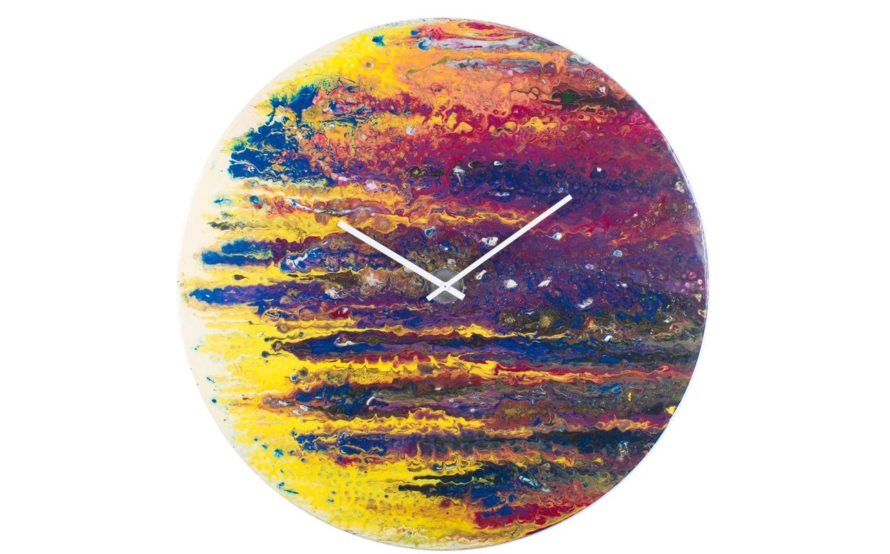 An Extra Large Circular Clock with Purple and Yellow streaks