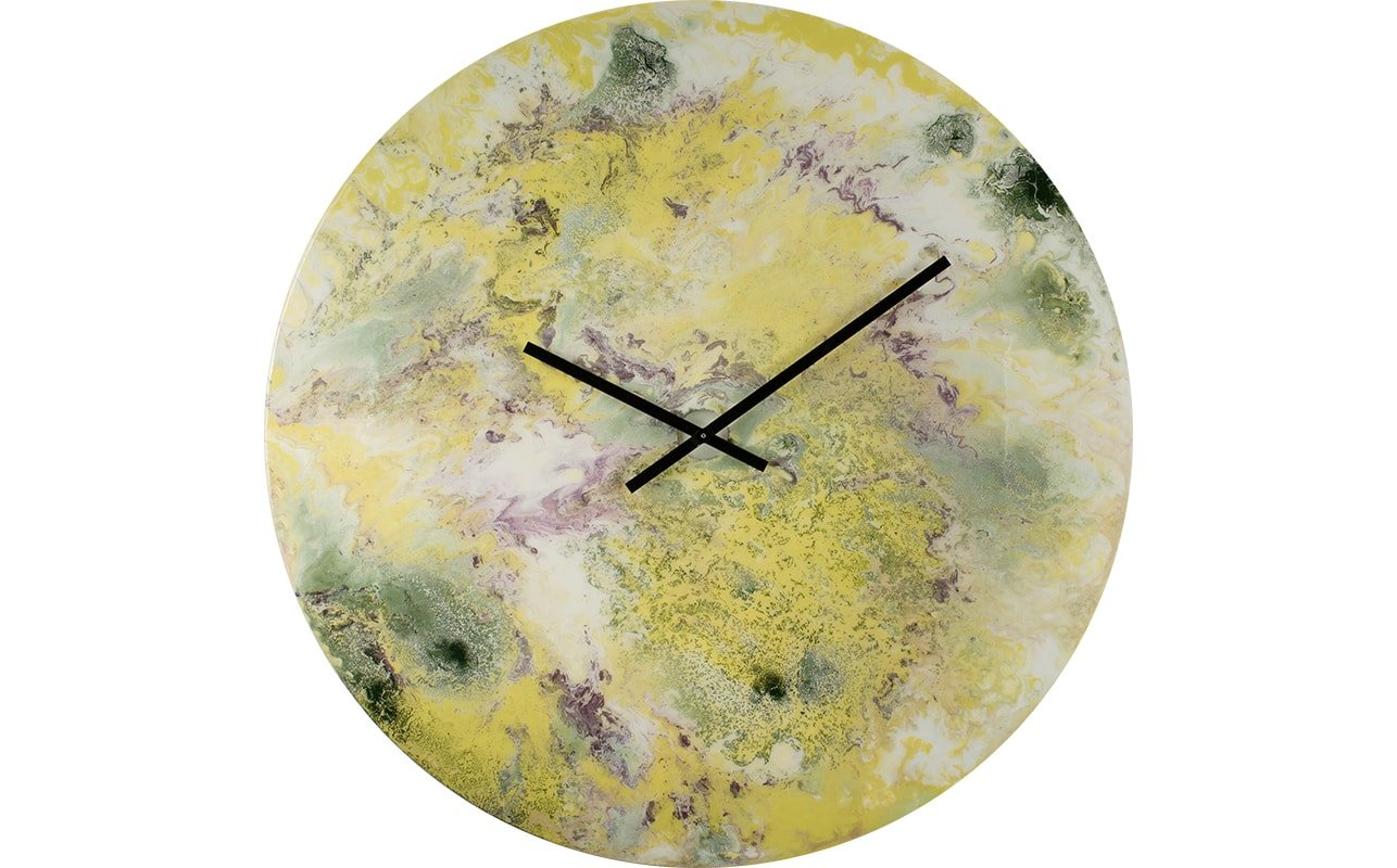 An Extra Large Yellow Wall Clock with an Abstract Design, additional Purple and Green Accents and Black Hands