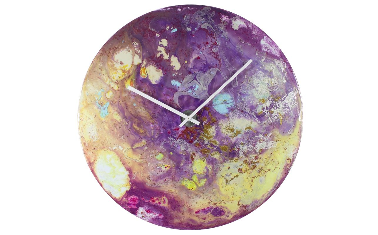 A Circular Purple Clock with an Abstract Design and White Hands